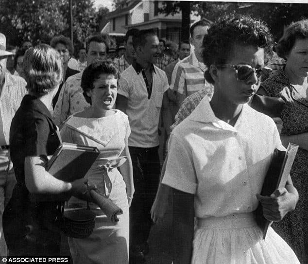 Elisabeth-Eckford-one-of-the-first-African-American-students-at-Little-Rock-Central-High-being-harassed-by-Hazel-Massery-1957.-Reddit